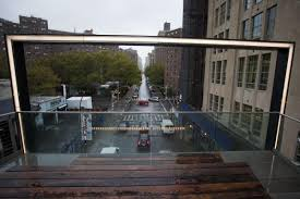 go to previous picture picture of view of a street through a frame with lighting and a bench bench lighting
