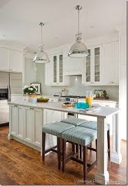 kitchen ideas decorating top of cabinets 6 foot long kitchen island chandeliers in over islands canadian tire faucets pendant light fittings