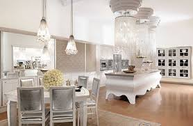 deluxe open kitchen space with silver countertop big three chandeliers and white silver dining table decor image