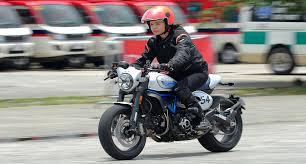 Actress Melanie Marquez rides a Ducati Scrambler
