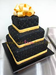 3 tier black and gold cake