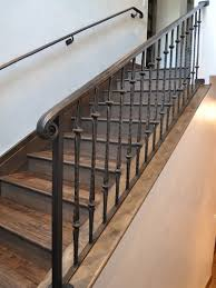 iron-hand-railing-in-fantastic-traditional-staircase-design-
