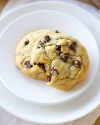 two chocolate chip cookies on a white plate