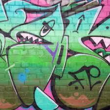 graffiti paintings on old brick wall