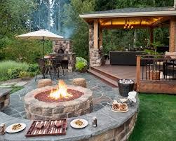 round brick fire pit in backyard ideas with stone floor design