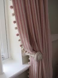 Striped curtains with pom pom trim A pair of full length pencil pleat  curtains with a