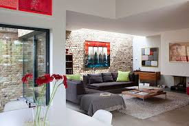 living roomvintage exposed brick wall in masculine living room design plus grey fabric sofa brick living room furniture
