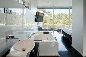 modern bedroom with bathroom. Wonderful Bedroom Modern Bedroom With Bathroom Black And White Modern Bedroom Interior  Design With Bathtub On Wood In Bathroom