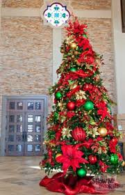 Christmas Tree decorated in traditional Red, Gold and Green with oversized  decorations for a big