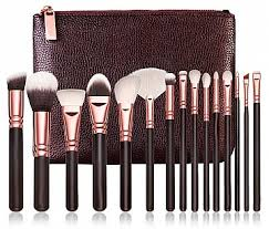 gold and black makeup brushes. revolt. brush kit rose gold 15 and black makeup brushes