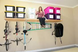garage wall organization. diy overhead wall mounted garage storage organization after remodel with plastic shelf and bike on the g
