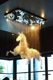 chandeliers chandelier restaurant saskatoon amazing horse chandelier for more dream home ideas follow my board