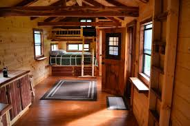 built in queen over king bunk bed cedar faced roll out storage drawers beneath walk in closet with cedar shelving loft above railing cedar rafters