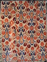 silk ikat rug orange red finish for contemporary living room floor idea