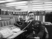 dr strangelove group captain mandrake sitting at an ibm 7090 console president merkin muffley dr strangelove