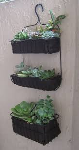 Fill IKEA shower caddies with potting liners (although this person did  felt, I strongly