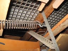 properly installed garage door extension spring safety cable 2