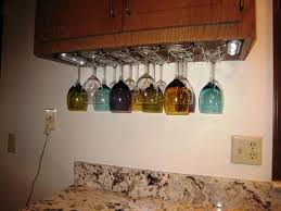 image of wood under cabinet wine glass rack