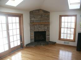 contemporary living room with corner fireplace with lovely best 25 corner stone fireplace ideas on