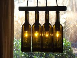 wine lighting. wine bottles turned into a beautiful lighting unit what gorgeous way to set p