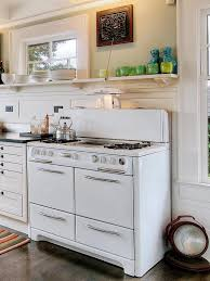 retro styled stove and oven for classic kitchen plan with white painted wood cabinet using open shelves