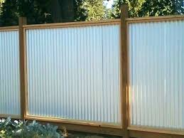 corrugated metal privacy fence and wood