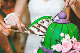 Shop by different occasions, themes, colors give your cake a creative touch with the addition of cake toppers from oriental trading. Green Purple Wedding Cake With Pink Flowers In An Oriental Style Stock Photo Picture And Royalty Free Image Image 54810780