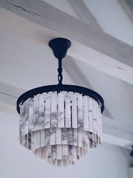 you can about the new timothy oulton odeon marble pendant on their website i strongly advise