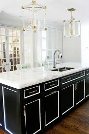 white and black kitchen cabinets. Brilliant And A Dated Kitchen Gets A Stunning Modern Makeover Black Kitchen Island  Lucite Pendants French Doors Mirrored Cabinets To White And Black Cabinets R