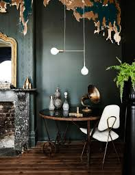 Bronze accents and the white light fixture with the white chair ...