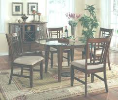 black dining room set round. Paula Dean Dining Room Sets Black Glass Round Table Set With Four Brown Wooden Chairs Having Grey Seat Pad On Areas Rug Plus Cabinet