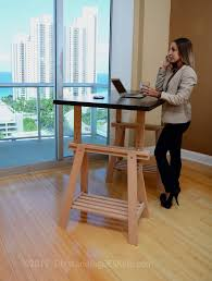 Diy adjustable standing desk Wood Our Standing Desk At An Office In Miami Kevin Jantzer The Heightadjustable Diy Standing Desk Ikea Conversion Kit