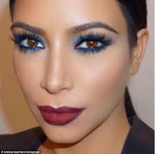 dramatic kim s final look featured a bold wine coloured lip and blue smoky eyes