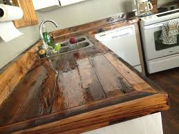 elegant glossy dark wood countertop painting formica cabinets with linoleum countertops and faucet