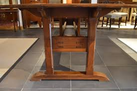 a rare oak arts crafts period dining table by arthur simpson of kendal having
