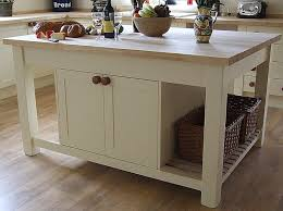 Small Kitchen with Portable White Kitchen Island, Movable Breakfast Bar,  and Natural Wood Top