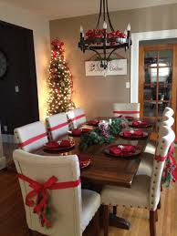 Dinning room for the Holidays. Tree in dinning room. Ribbons on chairs.  White. Skinny Christmas TreeChristmas HolidaysChristmas Decorations ...