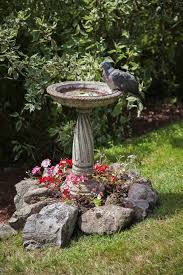 concrete baths also look good around stones and flowers with time concrete can gather