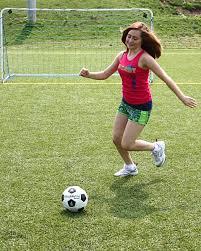 Teen girl ball kick