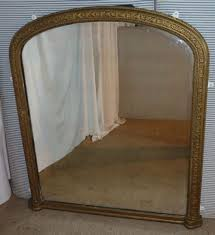 large victorian gold arched over mantle