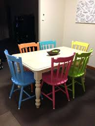 white dining table and coloured chairs multi colored dining chairs
