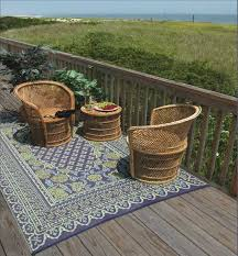 this reversible indoor outdoor rug from mad mats is made from recycled plastic bottles and ng materials its tubular threads absorb no stains
