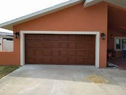 garage door wood lookNew Garage Door Painted to Look Like Red Mahogany Wood