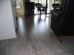 shaw gray laminate flooring shows hand hewn texture