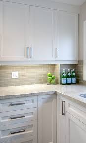 white shaker cabinets with quartz countertops. white shaker cabinets + gray subway backsplash---i would go with different colors quartz countertops i