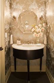 A true jewel-box of a powder room! The metallic toile wallpaper, faceted