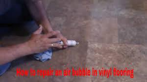 how to repair an air bubble in vinyl flooring
