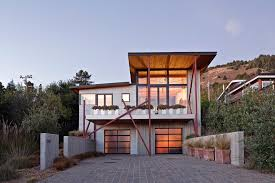 contemporary niche design exterior beach style with concrete wall frosted glass garage doors corrugated metal