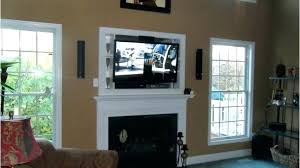 mounting a tv over a fireplace mounting over fireplace how to hide cords on wall mounted