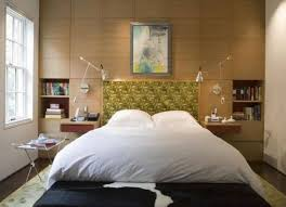 modern bedroom with swing arm wall sconceounted side tables